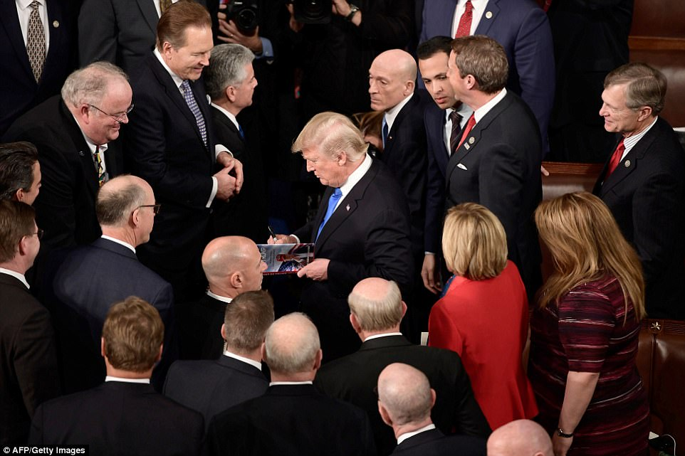 The president also signed a copy of his book after delivering the State of the Union address