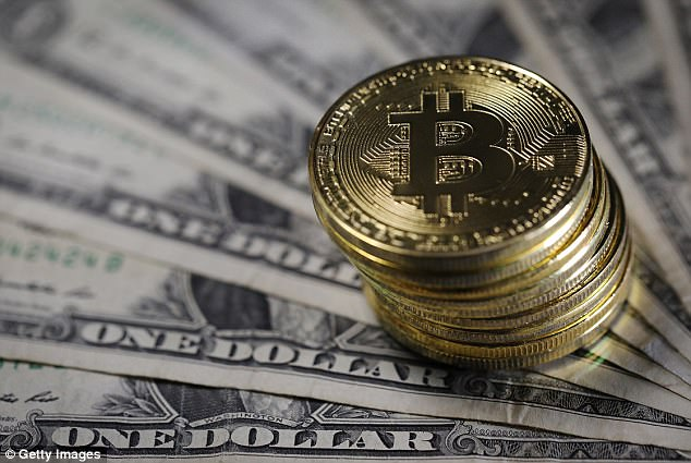 The company is banning initial coin offerings and cryptocurrencies including bitcoin (stock image). Initial coin offerings or ICOs are a way for companies to raise funds by selling investors cryptographic assets