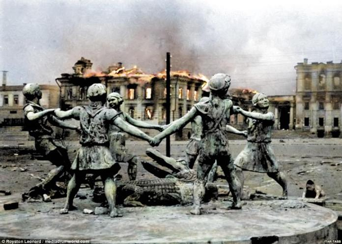 The city's famous fountain - 'Children dance' - was at the time situated on the Station Square. Here it is seen against the backdrop of a burning municipal building in the aftermath of a Nazi air raid