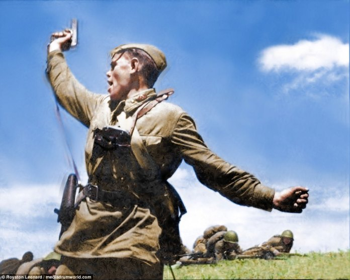 Political officers assigned to the Red Army boosted fighting morale by convincing the ordinary soldier that their's was a struggle for the civilians behind the lines who the Nazis wanted to enslave. Pictured: a Russian officer leading an offensive armed with a pistol