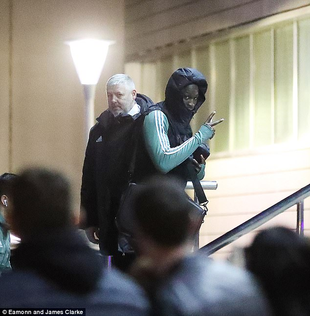 Romelu Lukaku gestures toward the crowds that had gathered outside the meeting point