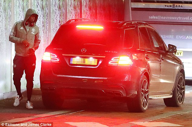Paul Pogba leaves his car parked up ahead of United's match against Huddersfield
