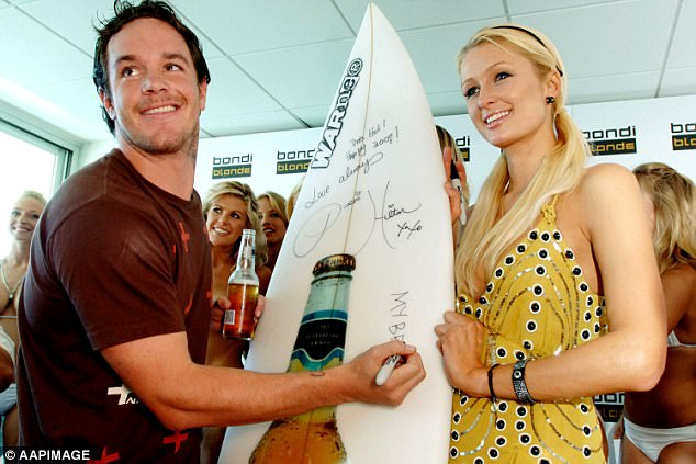 Koby Abberton (left) gave Paris Hilton (right) a surfboard and lessons at Bondi Beach in 2007