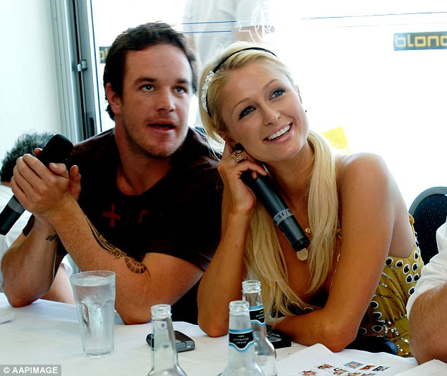 Paris Hilton with big wave rider Koby Abberton, who gave her surfing lessons at Bondi Beach