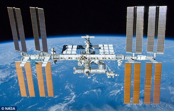 The International Space Station (file photo) is a $100 billion (£80 billion) science and engineering laboratory that orbits 250 miles (400 km) above Earth