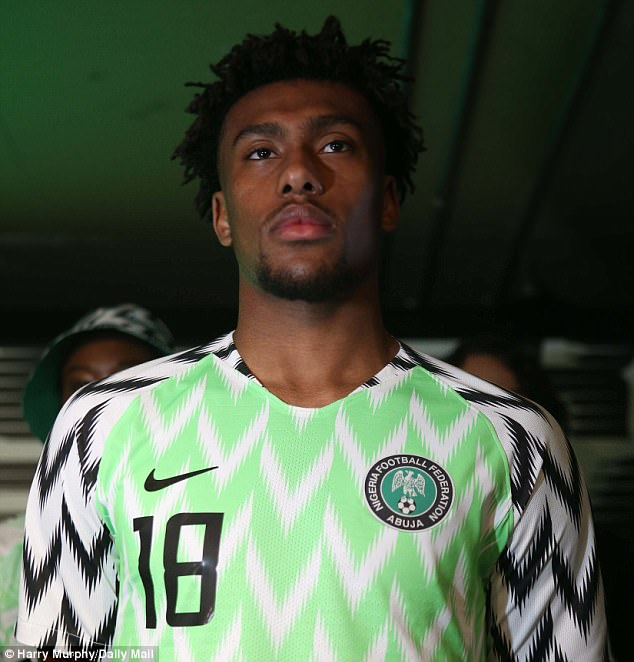 Iwobi models the bright green-and-white shirt featuring a feather-like abstract pattern