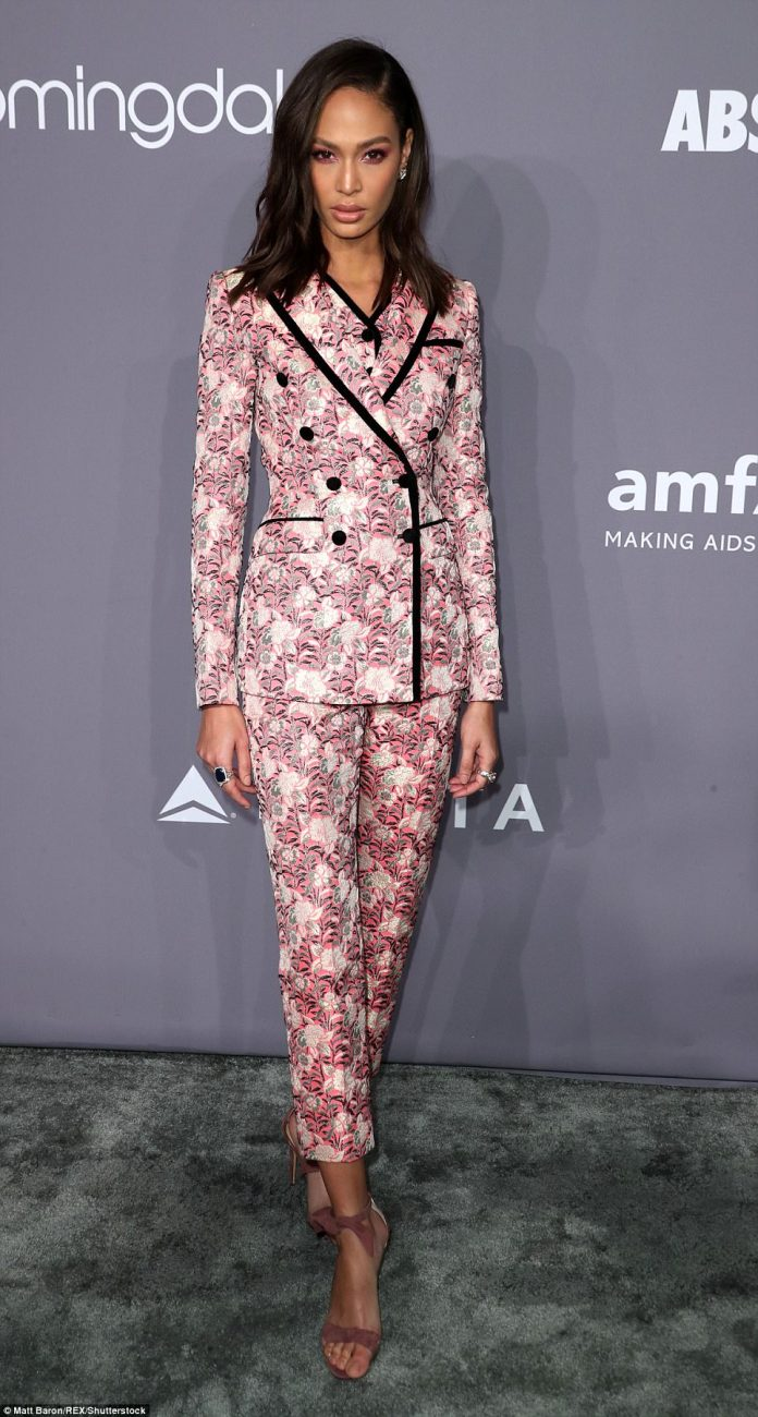 Model Joan Smalls, 29, was the epitome of style in a floral-themed suit that paired a tailored jacket with cropped trousers