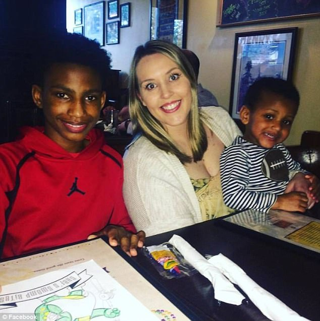 Jerome is now on the honor roll and hasn't been suspended from school since. He is pictured left smiling next to Haley and his joyful brother Jace, right