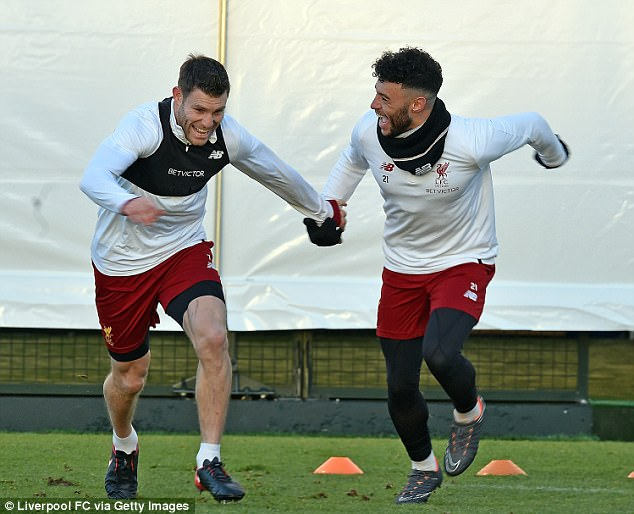 James Milner (left) and Alex Oxlade-Chamberlain were among the players in high spirits