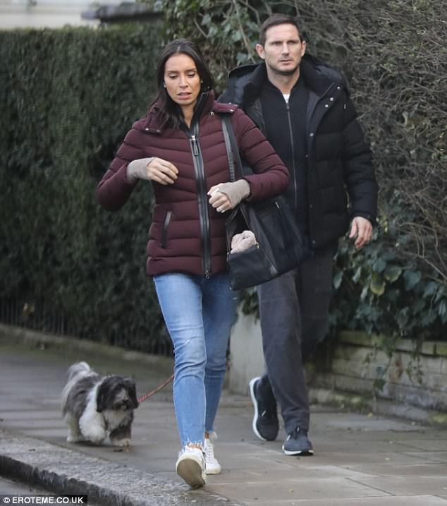 Sunday funday:Christine and Frank Lampard looked like it was still a case of puppy love as they took their pet pooch Minnie on a Sunday stroll in London's Knightsbridge