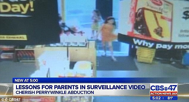 Footage: Security camera footage released by the State Attorney's Office shows Cherish (in orange dress), her sisters and her mother Rayne entering the Walmart store