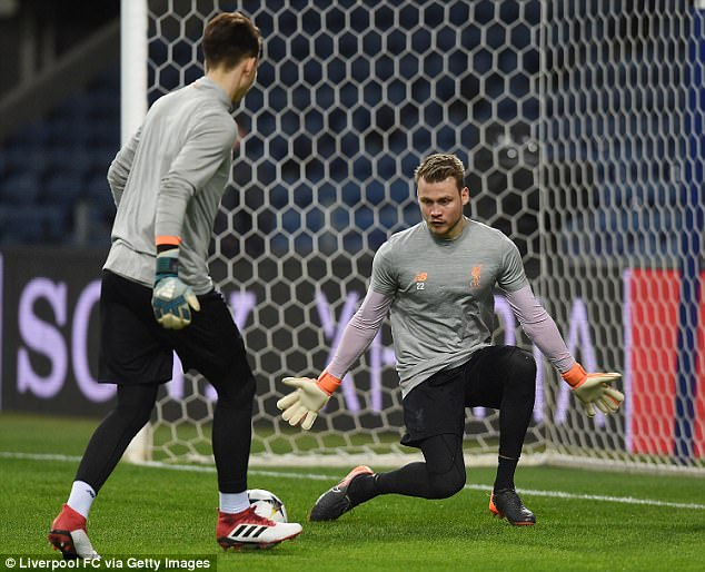 Simon Mignolet (right) in action during the Liverpool training session on Tuesday night