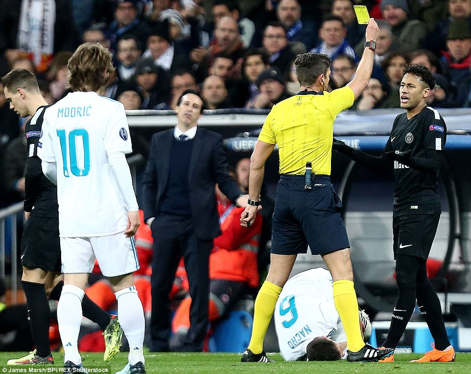 Neymar is shown a yellow card after a poor challenge on Madrid defender Nacho in the opening exchanges