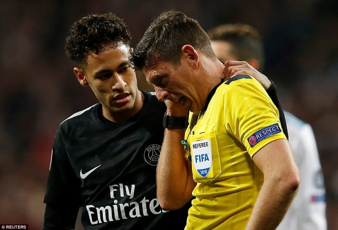 Neymar checks on referee Gianluca Rocchi after the Brazilian accidentally drilled the ball into his ear