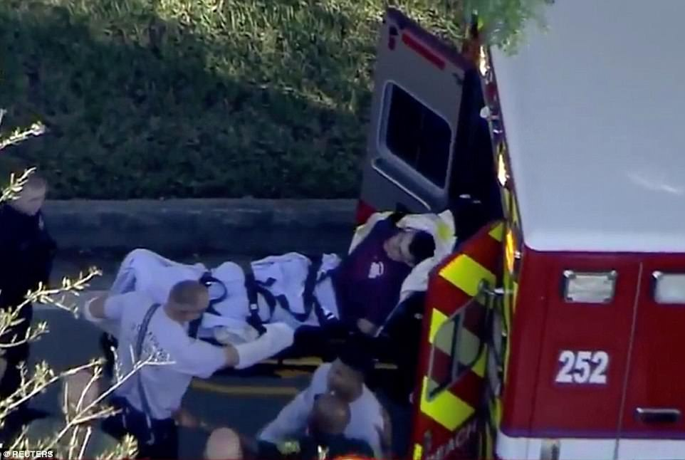 A student, on a stretcher, is loaded into the back of an ambulance after the mass shooting on Wednesday afternoon