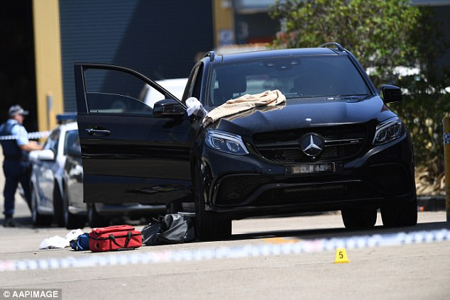 Hawi, 37, was shot by a masked gunman as he got into his luxury Mercedes SUV (pictured) at Fitness First in Rockdale, Sydney after midday on Thursday