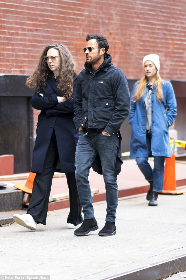 Brooding: Justin Theroux seen out with female friends in New York on Monday, shortly before news broke of Jennifer Aniston split