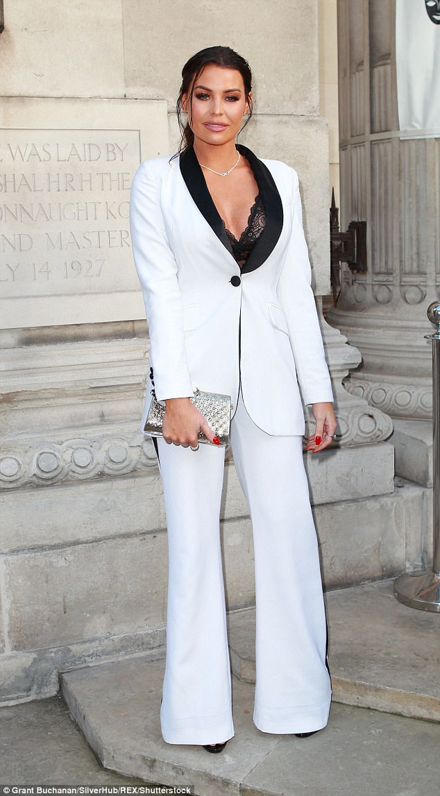 Statement: Jess Wright, 32, flashed her bra in a plunging white suit on Saturday as she attended the London Fashion Week Fashion Collective bash