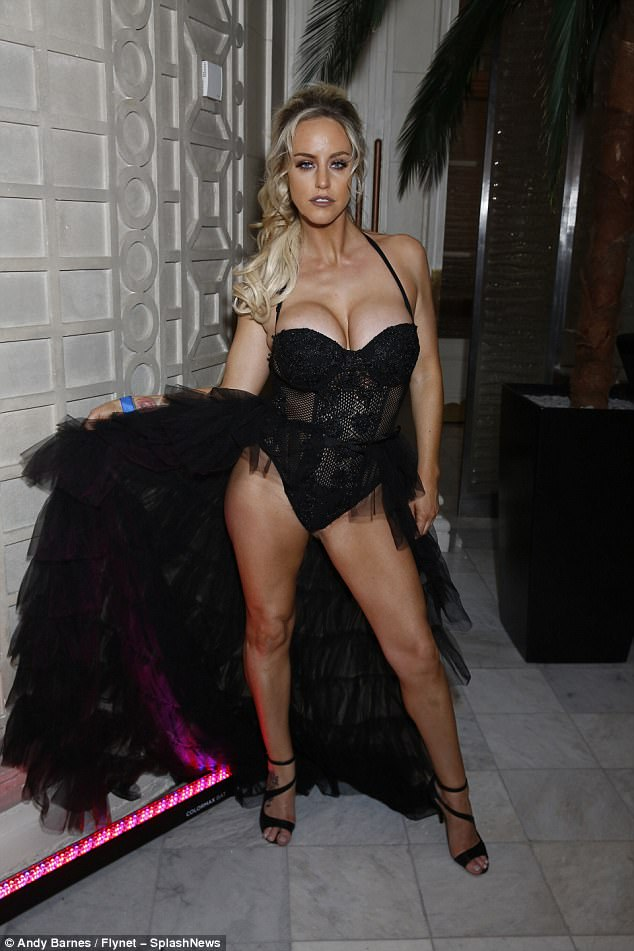 Dramatic: Reality TV thesp Danielle Mason also struggled to contain her ample cleavage in a dramatic black dress as she made her arrival at the charity bash