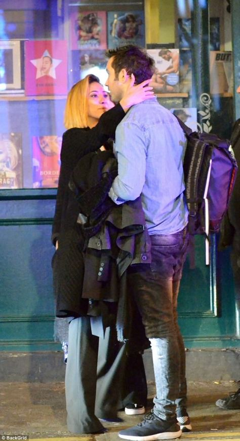 Getting close:Karen Clifton got cosy with a mystery man as she enjoyed a night out with friends in London on Saturday amid claims she and husband Kevin are 'set to divorce'