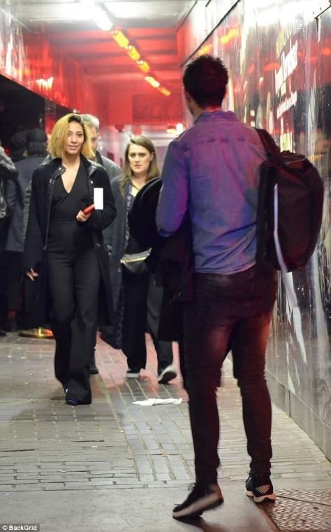 All eyes: Karen caught her male friend's attention as she walked towards him