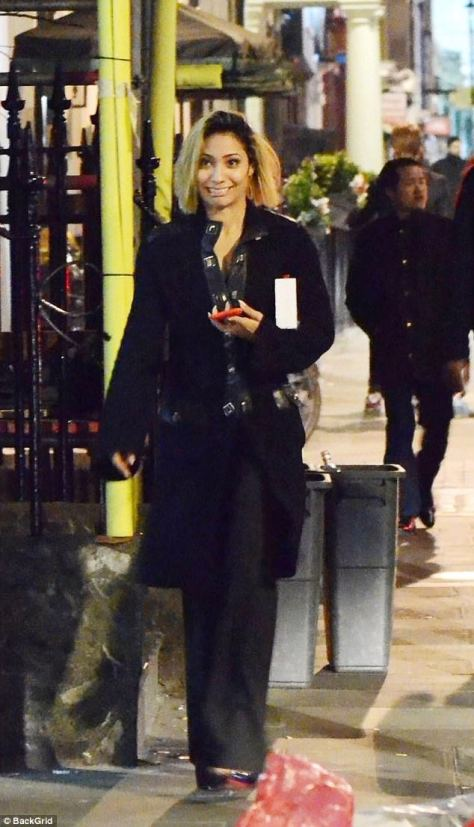 Funny faces: Karen pulled a strange look to friends as they left the London hot spot