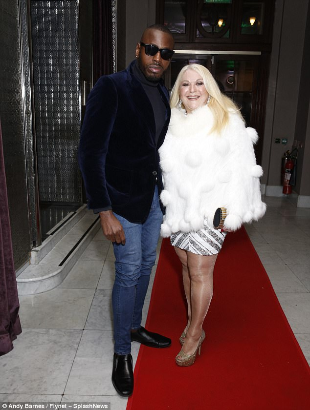 Couples night: Vanessa Feltz also made her arrival in a faux fur white coat as she attended the party with long-term partner Ben Ofoedu
