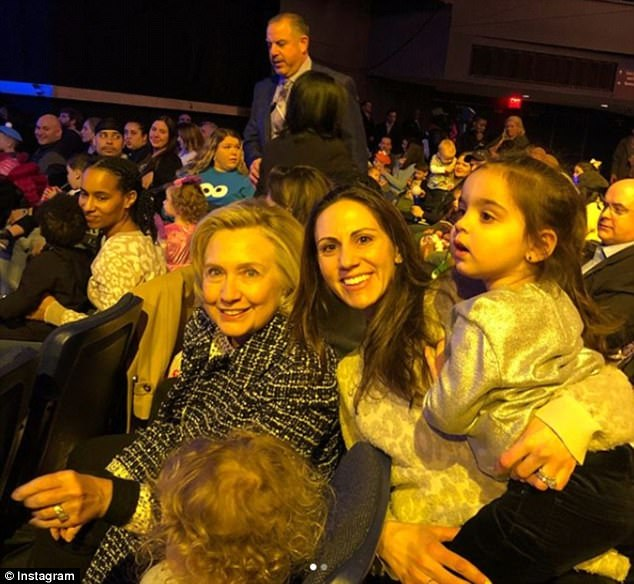Bill and Hillary Clinton took her two grandkids to see Sesame Street Live on Monday at Madison Square Garden in New York City. Hillary is see on the left, next to her granddaughter Charlotte, posing with a picture with another attendee