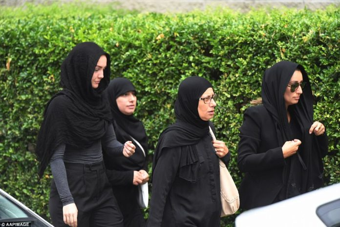 The service was well attended by men and women, who wore black head scarves and clothing