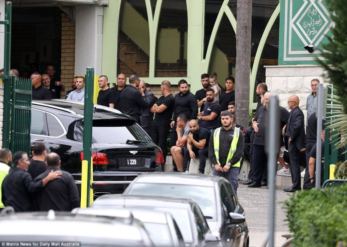 Huge crowds of men and children were seen in the driveway to the mosque, where a luxury car was parked