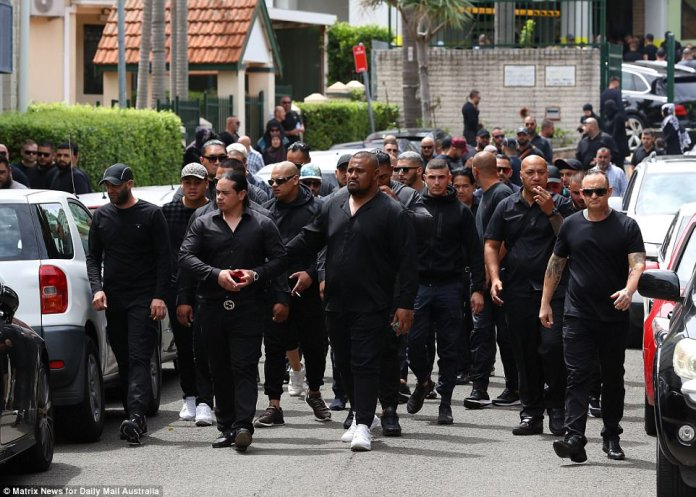 Following the service, mourners poured out of the mosque, all dressed in black