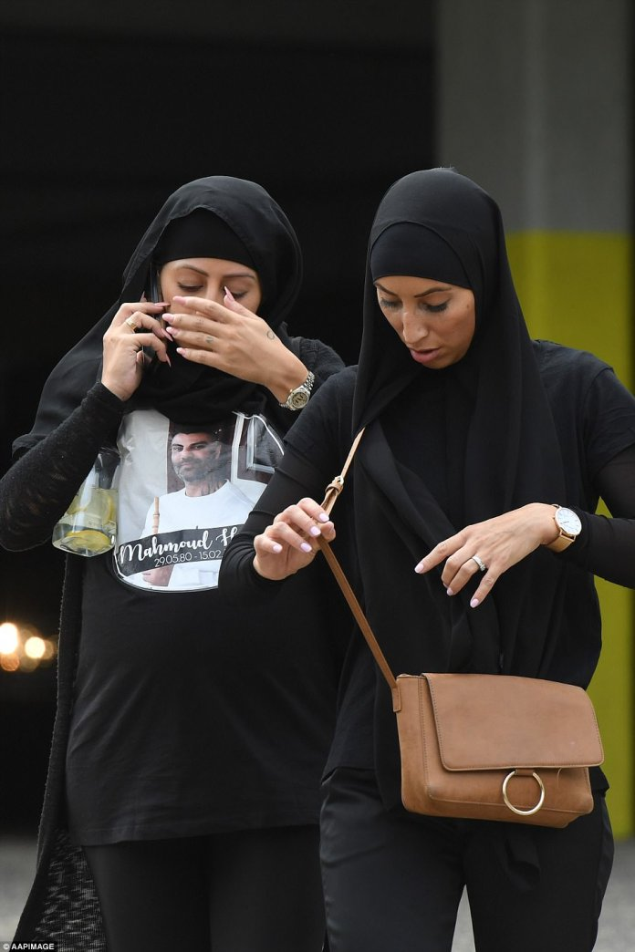Two women, one wearing a shirt with Hawi's face emblazoned on it, kept their heads bowed as they farewelled the beloved former Comancheros president