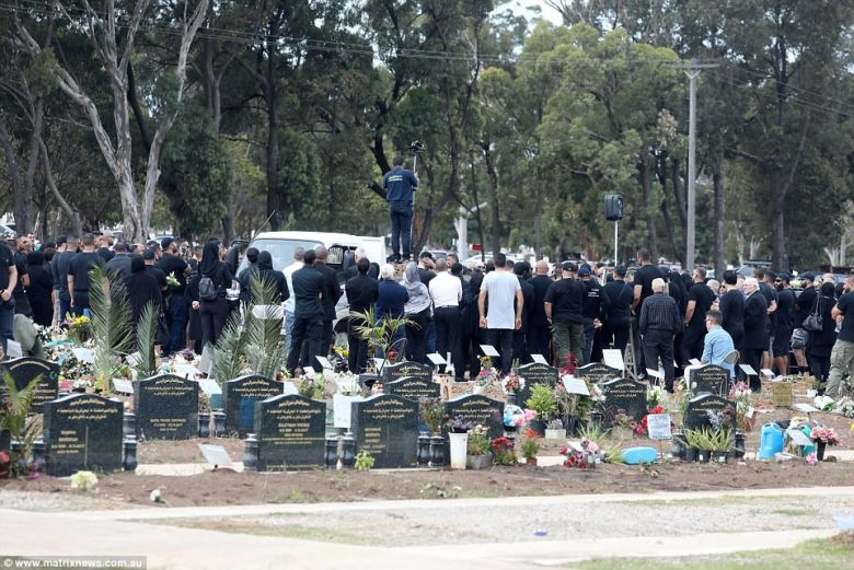 Hundreds attended the burial at Rookwood Cemetery near Lidcombe for the funeral of Hawi in Sydney on Thursday afternoon