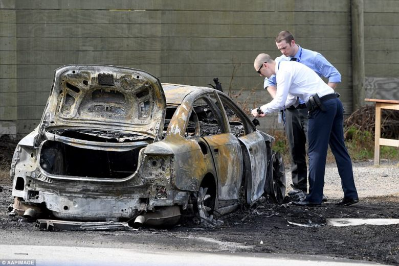 Police at the scene of a burnt out car in Robjant St, Hampton Park, near the scene of a shooting at a tattoo parlour in Melbourne. The men escaped in a silver saloon car before setting it on fire and are still on the run