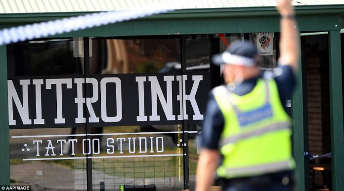 A tattoo parlour shooting that left a customer fighting for his life on the day of Mick Hawi's funeral could be linked to the Comanchero boss' murder, police say. Pictured: Nitro Ink
