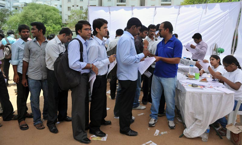 In this photograph taken on May 19, 2012 job-seekers wait in line to register at a career fair held at a school in Hyderabad. Low business confidence and high interest rates have led economic growth to plunge to the lowest in a decade, making private sector job opportunities harder to come by. Desperate candidates are forging qualifications, faking experience, inventing companies and resorting to all sorts of fraud to land jobs in a tough Indian employment market.— Photo by AFP