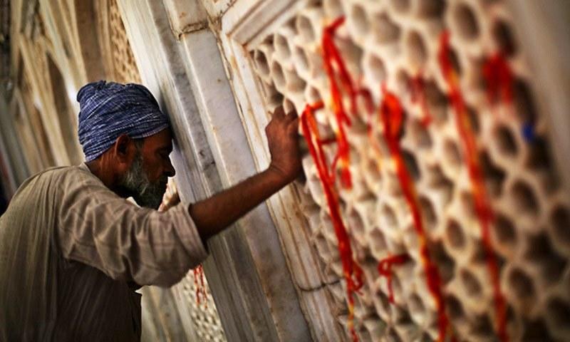 Sufi Muslim offering prayer in Rajasthan, India