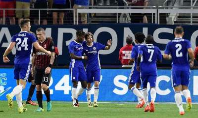 Chelsea celebrates a goal by Oscar as Juraj Kucka of AC Milan looks on during the second half of the International Champions Cup match on August 3.