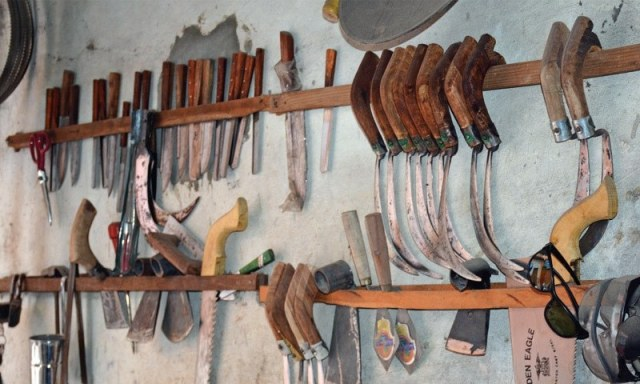 Farming tools displayed at an artisan's shop.