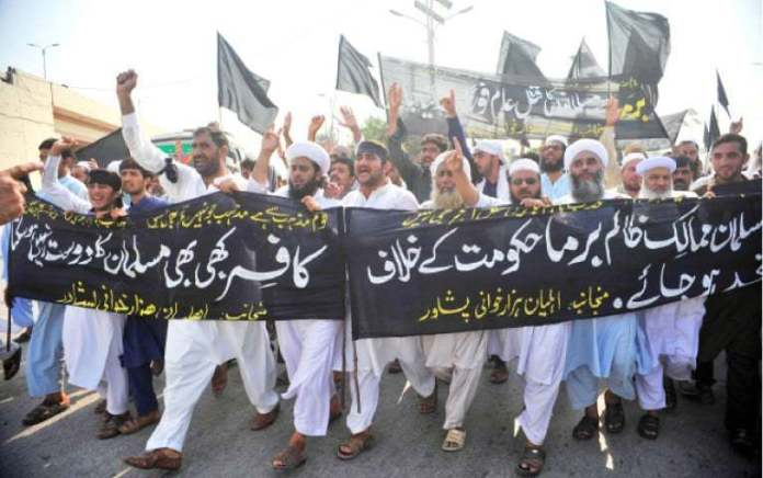 Protesters shout slogans during a rally in Peshawar on Thursday against killing of Rohingya Muslims in Myanmar. — White Star/File