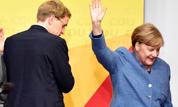German Chancellor and Christian Democrats party (CDU) leader Angela Merkel (R) leaves the stage after speaking during an election night event at the CDU party's headquarters in Berlin during the general election on September 24, 2017. —AFP