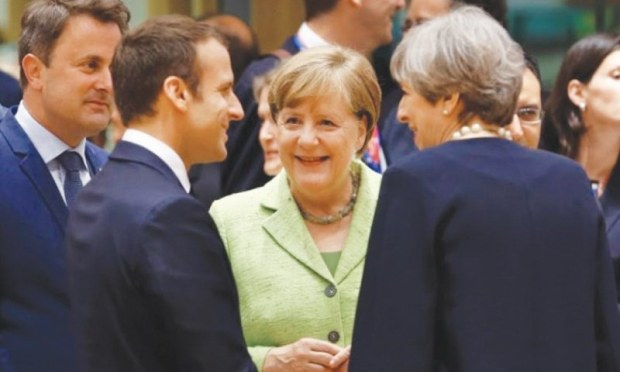 French President Emmanuel Macron, German Chancellor Angela Merkel and British PM Theresa May at the EU summit in Brussels, Belgium on June 22.— Reuters