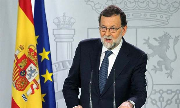 Spain's Prime Minister Mariano Rajoy gives a press conference after a crisis cabinet meeting at the Moncloa Palace.─AFP
