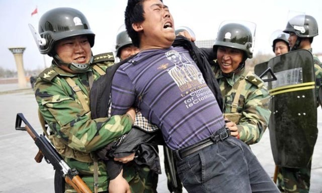 Image result for china xinjiang arrest