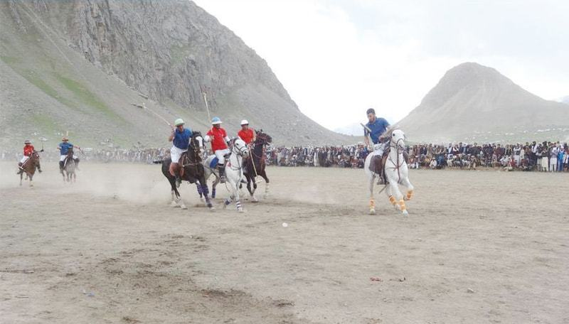 Final match of freestyle polo underway on the concluding day of Kagh Lusht festival in Upper Chitral on Sunday. — Dawn