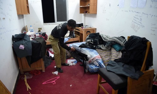 Policeman inspect Mashal Khan's hostel room. —AFP