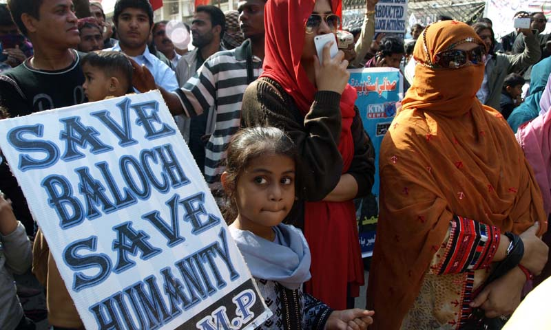 Relatives of missing persons demonstrate at Hyderabad Press Club in 2013 as they participate in a travelling march organised by Voice of Baloch Missing Persons from Balochistan to Islamabad.—Photo by INP