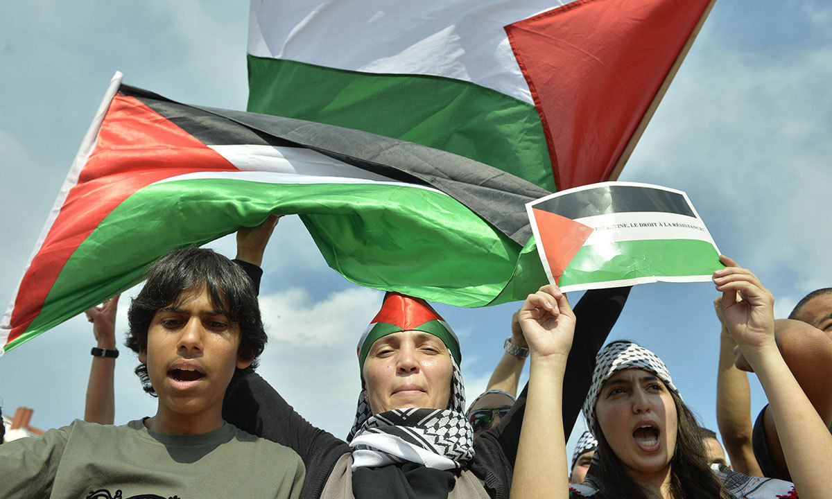 Image result for Protesters held up Palestinian flags and chanted slogans against Israeli, photos, july, 2017