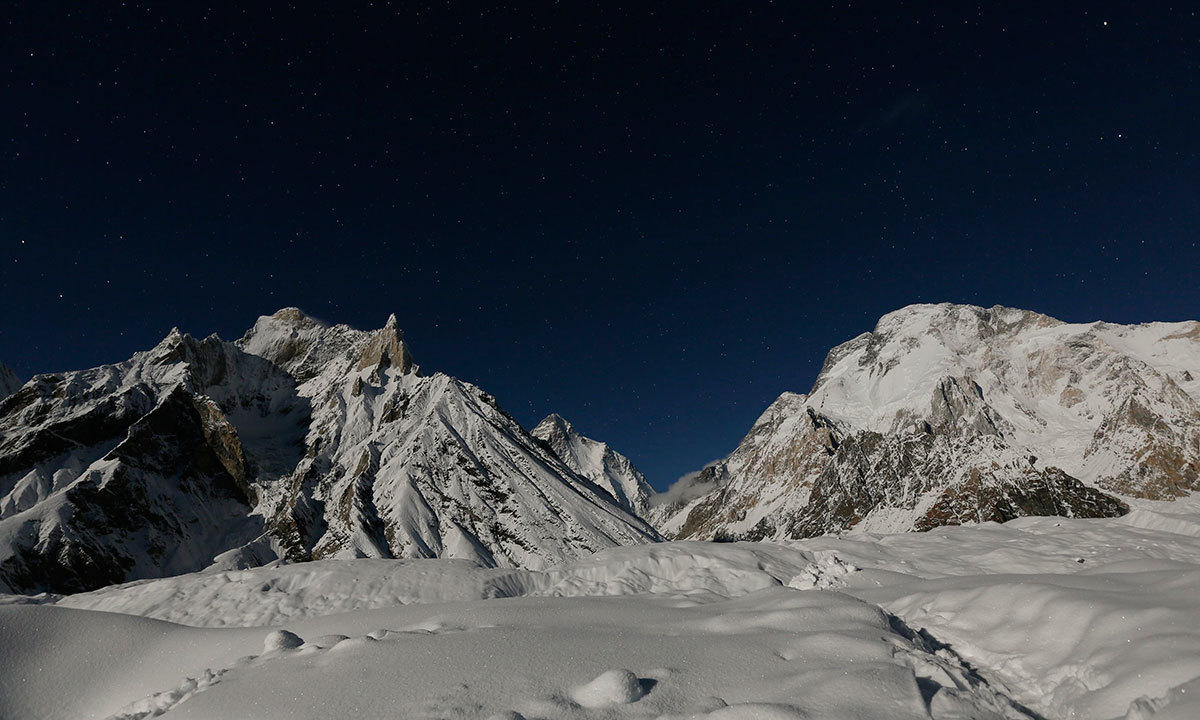 The world's second largest mountain, the 8,611 meter high K2 (seen in the distance), and the 8,051 meter high Broad Peak (R), are illuminated by the moon at Concordia, the confluence of the Baltoro and Godwin-Austen glaciers, in the Karakoram mountain range in Pakistan. -Reuters Photo