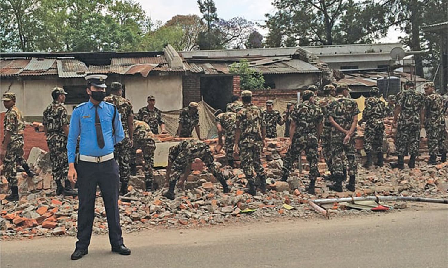 Even the army was short of equipment; here, at a barracks in downtown Kathmandu, the men of an infantry battalion had to remove the debris with their bare hands